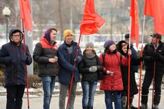 Orel, Russia - December 05, 2015: Truck drivers picket. Girls an. D boys with red communist flags horizontal Royalty Free Stock Image