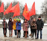 Orel, Russia - December 05, 2015: Truck drivers picket. Girls an. D parents with red communist flags in wintertime Stock Photos