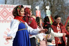 Orel, Russia - February 26, 2017: Maslenitsa fest. Girls in Russ. An sarafans and shawls singing closeup stock photography