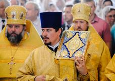 Orel, Russia, July 28, 2016: Russia Christianization anniversary Divine Liturgy. Priests in golden robes in front of crowd. Behind stock photography