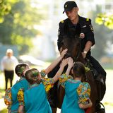 Orel, Russia - June 24, 2016: Turgenev Fest. Young Russian policeman on horse and little girls stroking it. Sqare royalty free stock photo