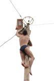 Orel, Russia, Maslenitsa Festival - 22 February, 2015: Man climb Stock Photo