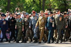 Orel, Russia - May 9, 2016: Celebration of 71th anniversary of t. He Victory Day (WWII). Russian Afganistan war veterans marching in parade horizontal Royalty Free Stock Images