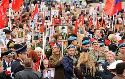 Orel, Russia - May 9, 2017: Victory Day selebration. Big crowd o. F people holding red Soviet flags and portraits of hero ancestors in Immortal Regiment crowd Royalty Free Stock Photos