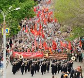 Orel, Russia - May 9, 2017: Victory Day selebration. Large crowd. Of people and military orchestra marching in Immortal regiment viewed from the height Stock Photography
