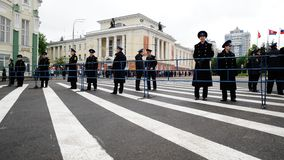 Orel, Russia - May 9, 2017: Victory Day selebration. Policemen s. Tanding along barrier in empty square horizontal Stock Photo
