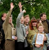 Orel, Russia - May 9, 2017: Victory Day selebration. Smiling peo. Ple in Soviet war uniform waving hands in Immortal Regiment square Royalty Free Stock Image