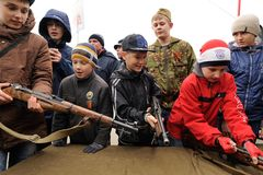 Orel, Russia - May 9, 2017: Victory Day selebration. Young boys. Playing with old guns Stock Image