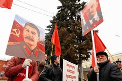 Orel, Russia, November 7, 2017: October Revolution anniversary m. Eeting. People standing with Stalin and Lenin portraits in hands Stock Images