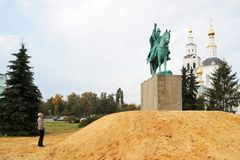 Orel, Russia - October, 01, 2016: Man watching Ivan the Terrible. Monument installed on heap of sand near Orthodox church horizontal Royalty Free Stock Image