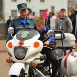 Orel, Russia, September 5, 2015: Boy sitting on rescue team moto Royalty Free Stock Photography