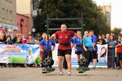 Orel, Russia, September 5, 2015: Man powerlifter carries heavy w. Eight on his shoulders in competition horizontal Royalty Free Stock Photos