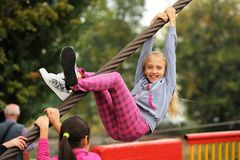 Orel, Russia, September 5, 2015: Smiling girl climbing steel rop. E closeup royalty free stock images