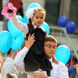 Orel, Russia - September 1, 2015: Young girl in school uniform r Royalty Free Stock Image