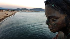Oren Mermaid statue. Burhaniye, Turkey - August 19, 2018; Mermaid statue on Oren Public beach royalty free stock photo
