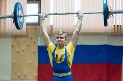 Orenburg, Rosja †'16 01 2016: Ciężkie atletyka współzawodniczą przeciw chłopiec Obraz Stock