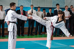 Orenburg, Russia - 23 April 2016: Taekwondo girl fingers legs pulls out a pencil Cup Royalty Free Stock Images