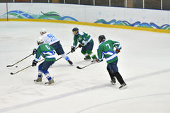 Orenburg, Russia - April 5, 2017 year: men play hockey Stock Photos