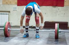 Orenburg, Russia – 16.01.2016: Heavy Athletics compete against boys Stock Images