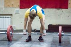 Orenburg, Russia – 16.01.2016: Heavy Athletics compete against boys Royalty Free Stock Photo