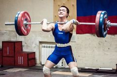 Orenburg, Russia – 16.01.2016: Heavy Athletics compete against boys Stock Photos