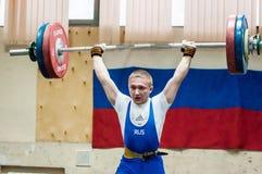 Orenburg, Russia – 16.01.2016: Heavy Athletics compete against boys Royalty Free Stock Photos
