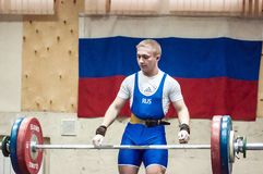 Orenburg, Russia – 16.01.2016: Heavy Athletics compete against boys Royalty Free Stock Images