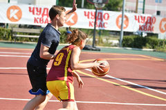 Orenburg, Russia - July 30, 2017 year: Girls and boys play Street Basketball Royalty Free Stock Photography
