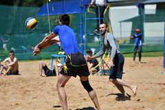 Orenburg, Russia, 9-10 June 2017 year: Boys playing beach volleyball Stock Photos