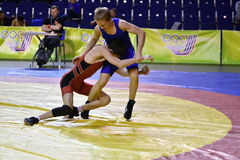 Orenburg, Russia 16 March 16, 2017 year: Boys compete in freestyle wrestling. Orenburg, Russia - March 16, 2017 year: Boys compete in freestyle wrestling on Royalty Free Stock Photos