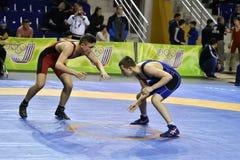Orenburg, Russia 16 March 16, 2017 year: Boys compete in freestyle wrestling. Orenburg, Russia - March 16, 2017 year: Boys compete in freestyle wrestling on Stock Photography