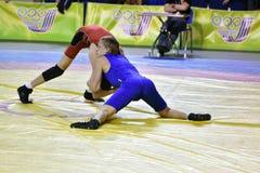 Orenburg, Russia 16 March 16, 2017 year: Boys compete in freestyle wrestling. Orenburg, Russia - March 16, 2017 year: Boys compete in freestyle wrestling on Stock Photo