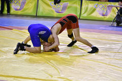 Orenburg, Russia 16 March 16, 2017 year: Boys compete in freestyle wrestling. Orenburg, Russia - March 16, 2017 year: Boys compete in freestyle wrestling on Royalty Free Stock Images