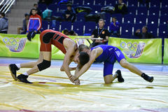 Orenburg, Russia 16 March 16, 2017 year: Boys compete in freestyle wrestling. Orenburg, Russia - March 16, 2017 year: Boys compete in freestyle wrestling on Royalty Free Stock Photography