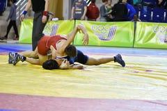 Orenburg, Russia 16 March 16, 2017 year: Boys compete in freestyle wrestling. Orenburg, Russia - March 16, 2017 year: Boys compete in freestyle wrestling on Royalty Free Stock Photo