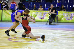 Orenburg, Russia 16 March 16, 2017 year: Boys compete in freestyle wrestling Royalty Free Stock Images