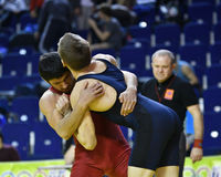 Orenburg, Russia - March 16, 2017 year: Boys compete in freestyle wrestling. On privolzhskiy Federal District Championships among boys 2001-2000 biennium of Royalty Free Stock Photo