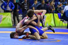 Orenburg, Russia - March 16, 2017 year: Boys compete in freestyle wrestling. On privolzhskiy Federal District Championships among boys 2001-2000 biennium of Stock Images