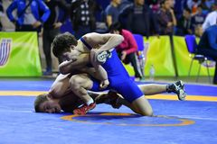 Orenburg, Russia - March 16, 2017 year: Boys compete in freestyle wrestling. On privolzhskiy Federal District Championships among boys 2001-2000 biennium of Royalty Free Stock Image