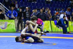 Orenburg, Russia - March 16, 2017 year: Boys compete in freestyle wrestling. On privolzhskiy Federal District Championships among boys 2001-2000 biennium of Stock Photo
