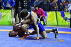Orenburg, Russia - March 16, 2017 year: Boys compete in freestyle wrestling. On privolzhskiy Federal District Championships among boys 2001-2000 biennium of Stock Photography