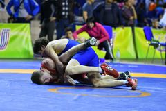 Orenburg, Russia - March 16, 2017 year: Boys compete in freestyle wrestling. On privolzhskiy Federal District Championships among boys 2001-2000 biennium of Royalty Free Stock Photos