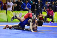 Orenburg, Russia - March 16, 2017 year: Boys compete in freestyle wrestling. On privolzhskiy Federal District Championships among boys 2001-2000 biennium of Royalty Free Stock Photography