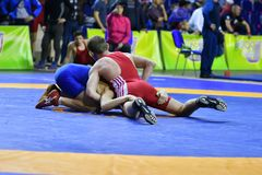 Orenburg, Russia - March 16, 2017 year: Boys compete in freestyle wrestling. On privolzhskiy Federal District Championships among boys 2001-2000 biennium of Stock Image