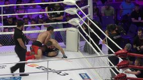 Orenburg, Russia - 27 May 2016: The fighters compete in mixed martial arts. In the Championship of Russia stock video footage