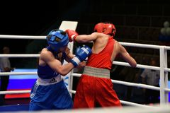 Orenburg, Russia-May 6, 2017 year: Boys boxers compete. Orenburg, Russia - May 6, 2017 year: Boys boxers compete in the Championship of Russia in boxing among royalty free stock images
