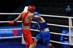 Orenburg, Russia-May 6, 2017 year: Boys boxers compete. Orenburg, Russia - May 6, 2017 year: Boys boxers compete in the Championship of Russia in boxing among stock image