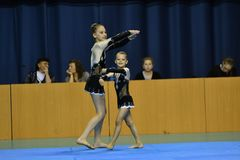 Orenburg, Russia, 26-27 May 2017 year years: girl compete in sports acrobatics. Orenburg, Russia, 26-27 May 2017 year: girl compete in sports acrobatics at the stock photos