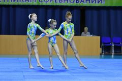 Orenburg, Russia, 26-27 May 2017 year years: girl compete in sports acrobatics. Orenburg, Russia, 26-27 May 2017 year: girl compete in sports acrobatics at the royalty free stock image