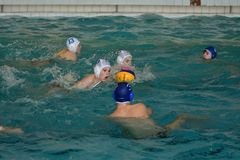 Orenburg, Russia - May 4, 2017 years: the boys play in water polo Royalty Free Stock Photo